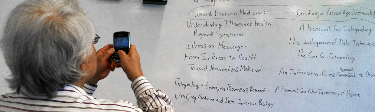 "Keith Yamamoto takes picture of white board with ""Precision Medicine"" selected among other terms"